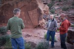 Guy, Ron, and Tom discuss the detailed rock art behind them